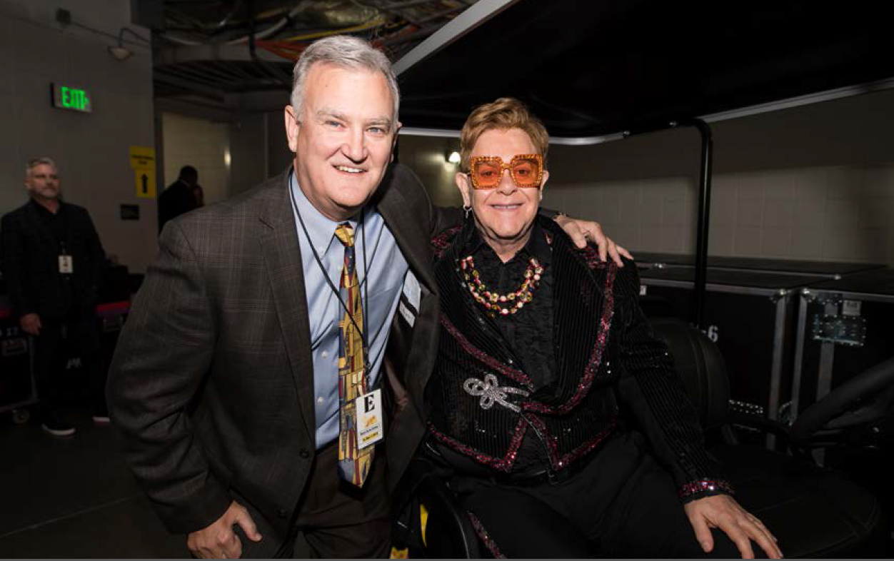 Two Yamahas One Passion: Golf-Car Company Presents Custom Cars to Elton John to Benefit AIDS Foundation